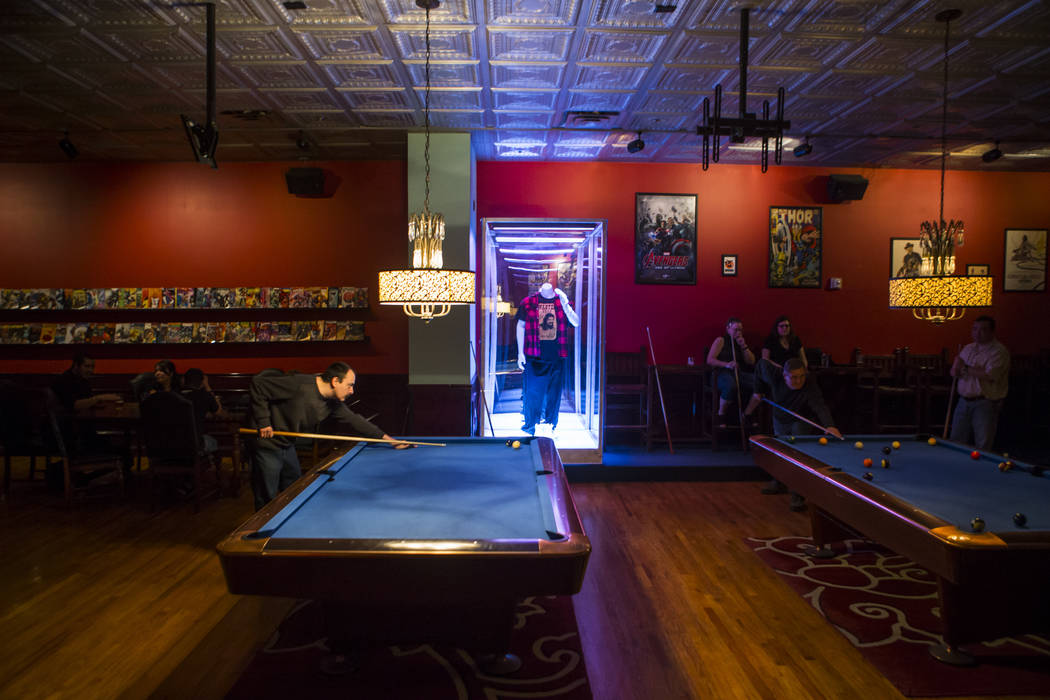 Alex Calderon, left, plays on one of the multiple pool tables at The Nerd nightclub at Neonopolis in downtown Las Vegas on Saturday, April 8, 2017. Chase Stevens View @csstevensphoto