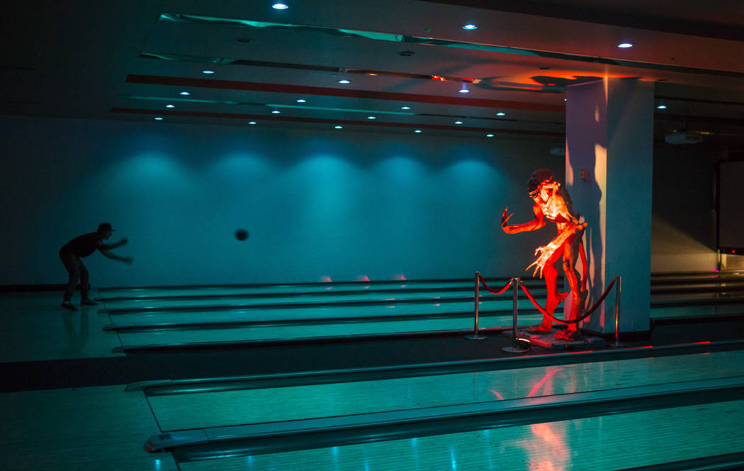 A life-size Alien statue adorns the 12-lane bowling alley at The Nerd nightclub at Neonopolis in downtown Las Vegas on Saturday, April 8, 2017. Chase Stevens View @csstevensphoto