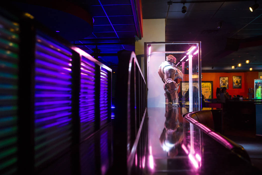 """A life-size Hammer Drone from """"Iron Man,"""" right, at The Nerd nightclub at Neonopolis in downtown Las Vegas on Saturday, April 8, 2017. Chase Stevens View @csstevensphoto"""