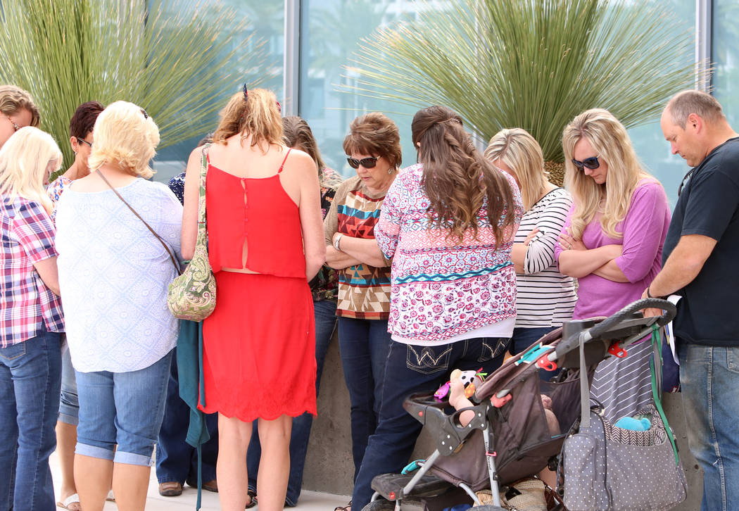 Carol Bundy, wife of rancher Cliven Bundy, center, pray with supporters outside Lloyd George Federal Building on Monday, April 24, 2017, in Las Vegas. Bizuayehu Tesfaye Las Vegas Review-Journal @b ...