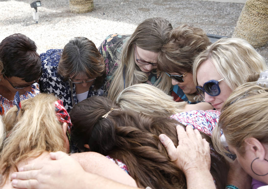 Carol Bundy, wife of rancher Cliven Bundy, third right, prays with her daughter Bailey Louge, third left, and supporters outside Lloyd George U.S. Courthouse on Monday, April 24, 2017, in Las Vega ...