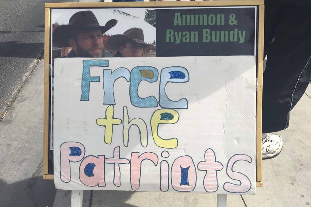 A protestor's sign outside the Lloyd George U.S. Courthouse as a jury has reached a verdict in the first trial of men charged in the 2014 armed standoff in Bunkerville, Monday, April 24, 2017. Biz ...