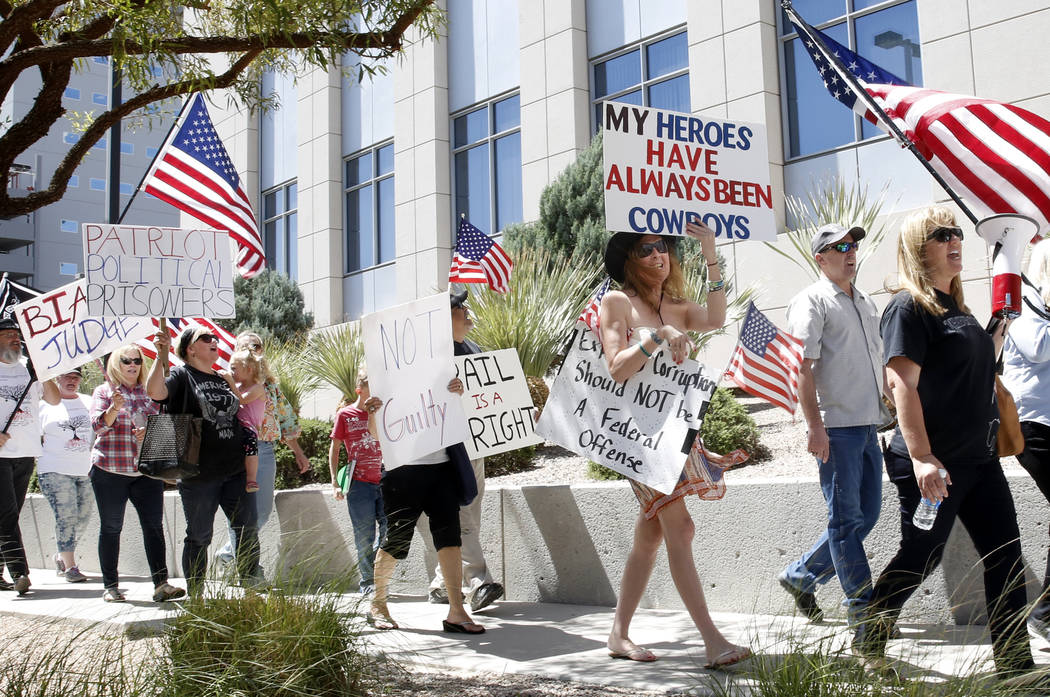 Protesters outside the Lloyd George U.S. Courthouse, where lawyers were giving closing arguments in the first Bunkerville standoff trial, on Wednesday, April 12, 2017, in Las Vegas. Bizuayehu Tesf ...