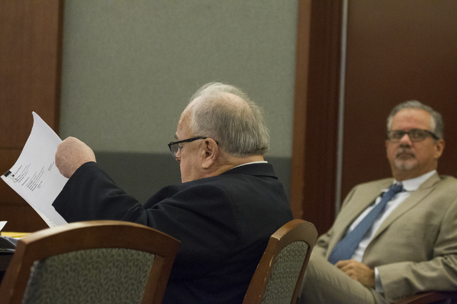 Defense attorneys Tom Pitaro, left, and Ozzie Fumo, attend the court hearing on whether to allow the death penalty for their client Eric Covington, who prosecutors say stabbed his estranged girlfr ...