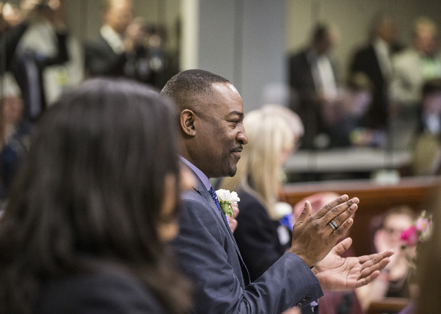 Assemblyman Tyrone Thompson claps for newly sworn in legislators during the start of the first day of the Nevada Legislative session on Monday, Feb. 6, 2017, at the Legislative Building, in Carson ...