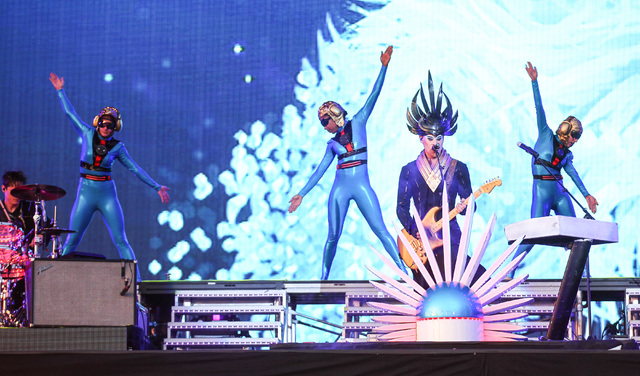 Luke Steele of Empire of the Sun, third from left, performs at the main stage during the Rock in Rio USA music festival in Las Vegas on Saturday, May 16, 2015. (Chase Stevens/Las Vegas Review-Jour ...