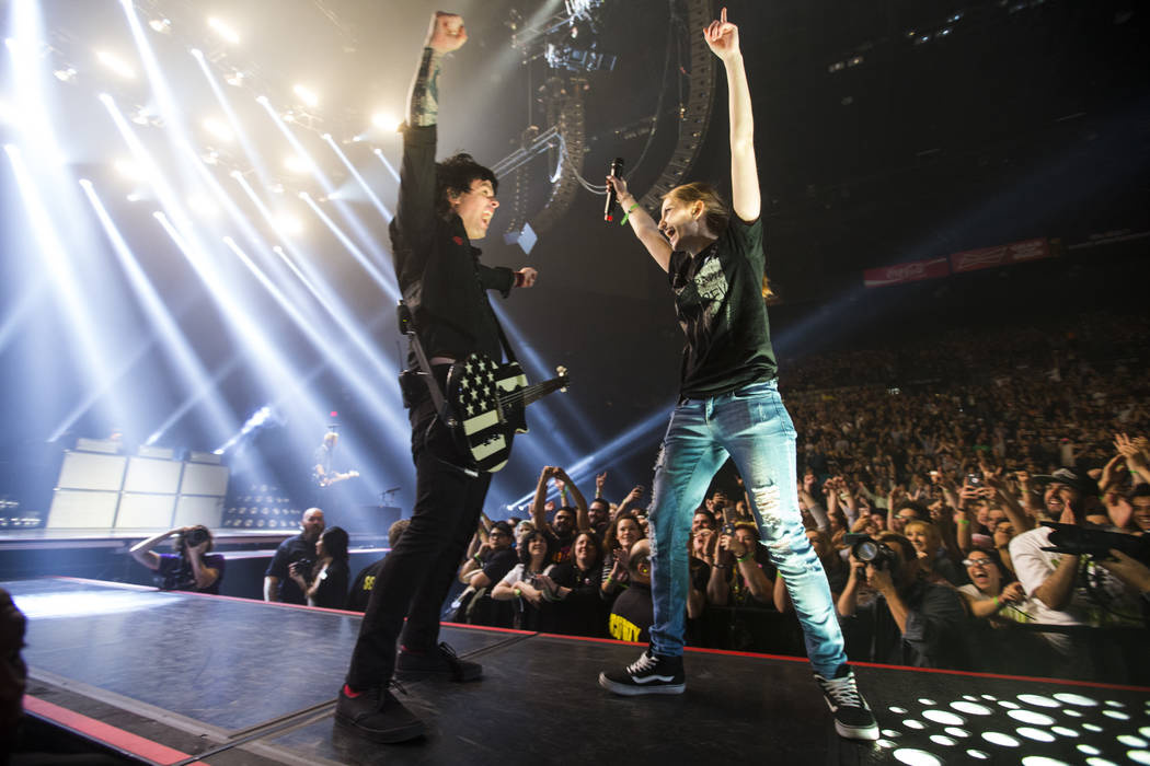 Billie Joe Armstrong of Green Day brings a fan to the stage while performing at the MGM Grand Garden Arena in Las Vegas on Friday, April 7, 2017. Chase Stevens Las Vegas Review-Journal @csstevensphoto
