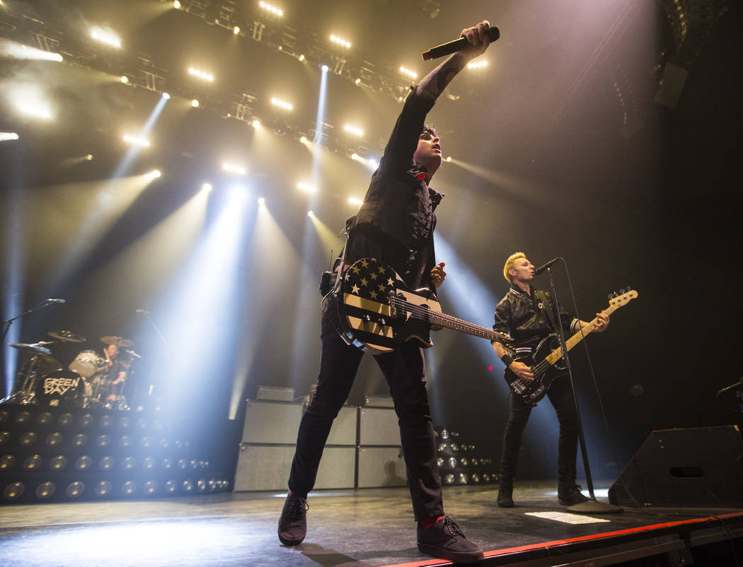 Green Day, from left, Tre Cool, Billie Joe Armstrong and Mike Dirnt perform at the MGM Grand Garden Arena in Las Vegas on Friday, April 7, 2017. Chase Stevens Las Vegas Review-Journal @csstevensphoto