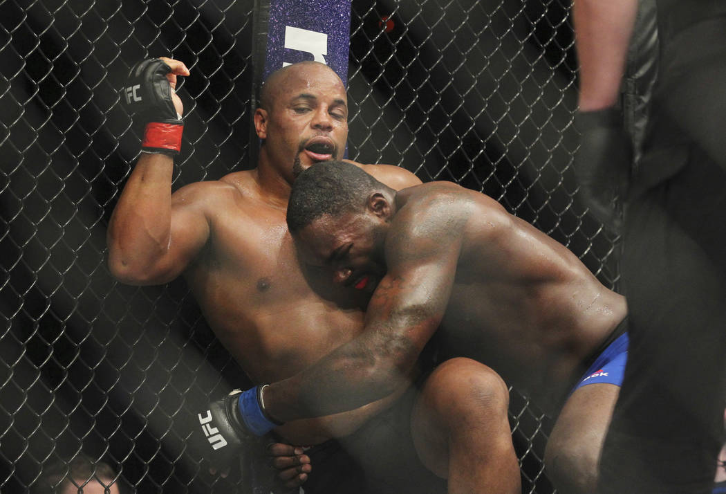 Daniel Cormier, left, battles Anthony Johnson during a light heavyweight mixed martial arts bout at UFC 210, early Sunday, April 9 2017, in Buffalo, N.Y. (Jeffrey T. Barnes/AP)