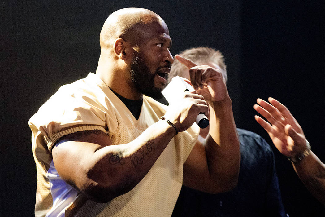 Team coach and former NFL linebacker James Harrison talks to the opposing team at the inaugural Pro Football Armwrestling Championship, which was filmed at the MGM Grand hotel-casino in Las Vegas, ...