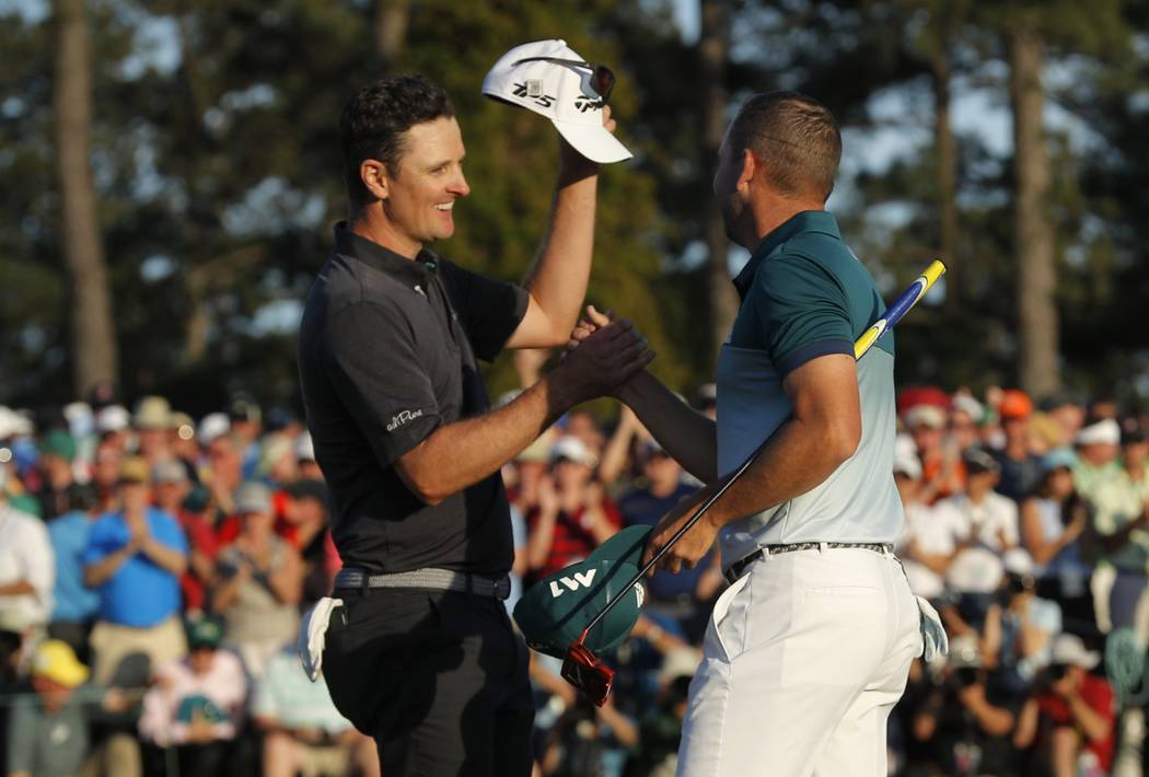 Justin Rose of England (L) and Sergio Garcia of Spain shake hands after finishing regulation play tied in the final round of the 2017 Masters golf tournament at Augusta National Golf Club in Augus ...