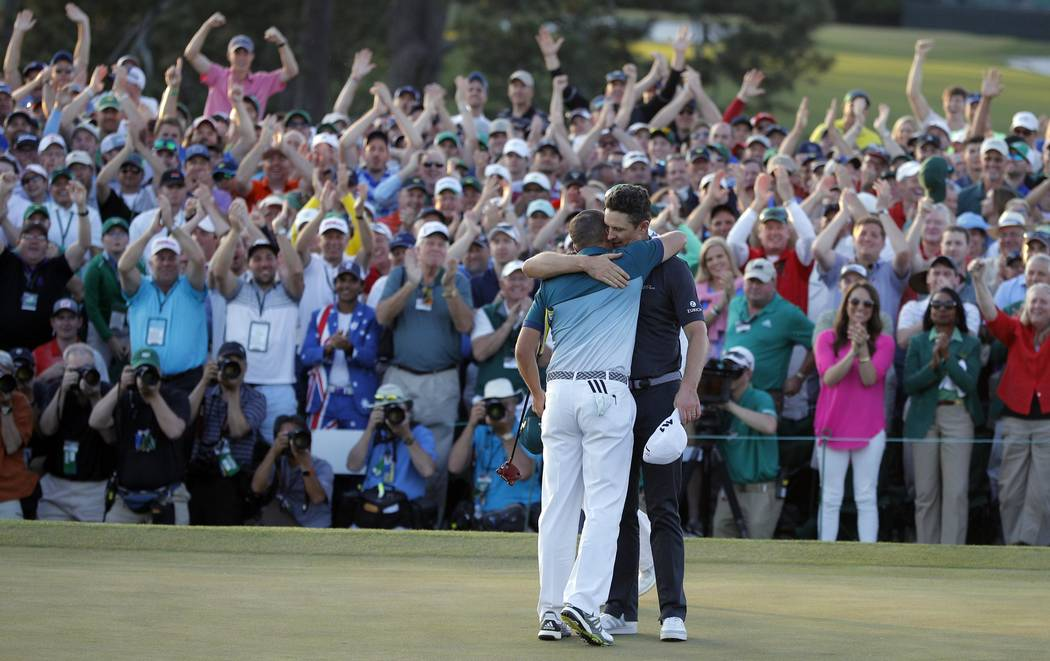 Justin Rose of England congratulates Sergio Garcia of Spain (L) after Garcia won the Masters in a final round playoff during the 2017 Masters golf tournament at Augusta National Golf Club in Augus ...