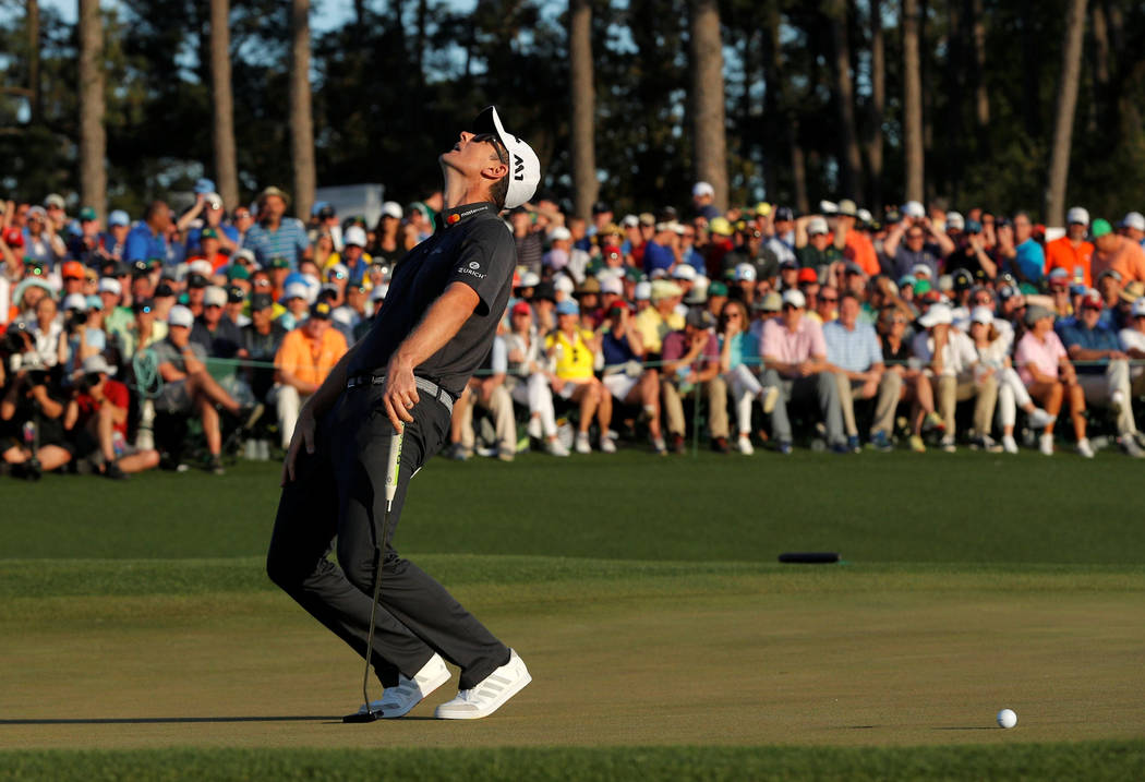 Justin Rose of England reacts to missing his putt on the 18th green during regulation play in the final round of the 2017 Masters golf tournament at Augusta National Golf Club in Augusta, Georgia, ...