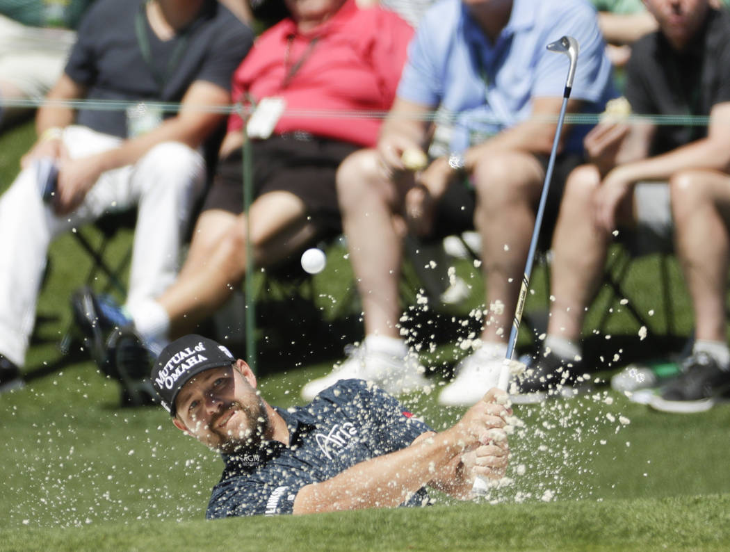 Ryan Moore hits from a bunker on the second hole during the final round of the Masters golf tournament Sunday, April 9, 2017, in Augusta, Ga. (AP Photo/Matt Slocum)