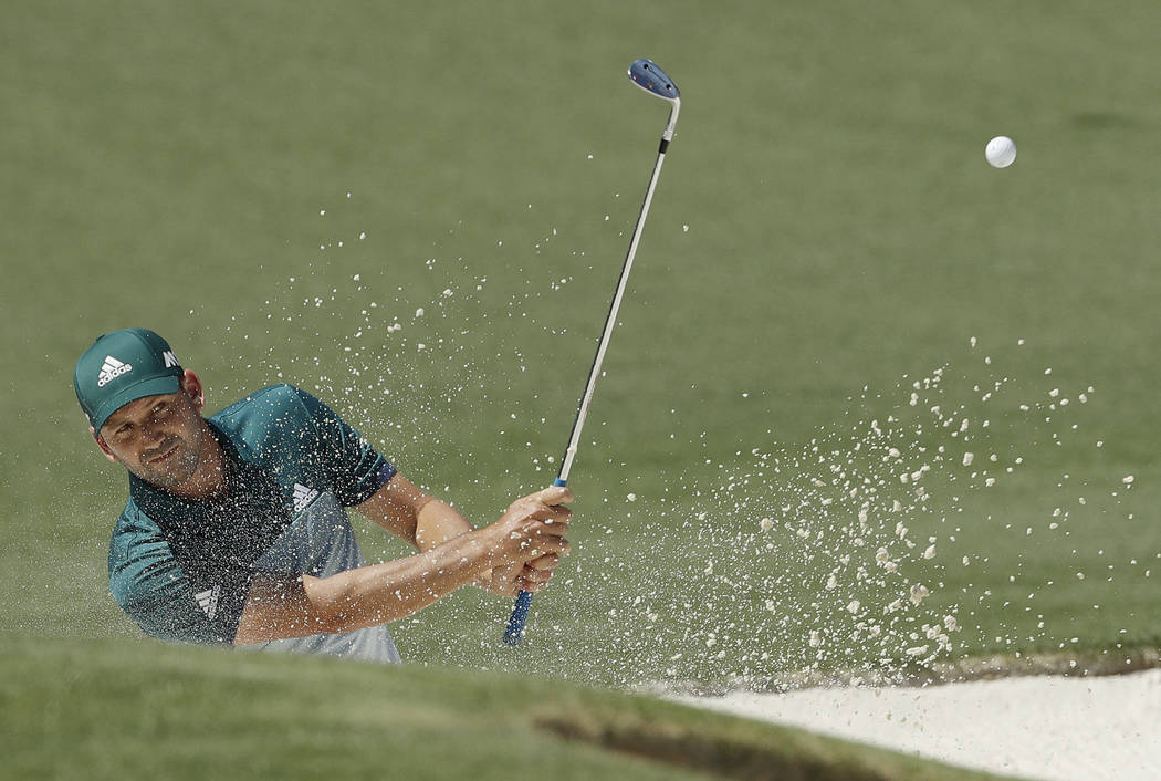 Sergio Garcia, of Spain, hits from a bunker on the second hole during the final round of the Masters golf tournament Sunday, April 9, 2017, in Augusta, Ga. (AP Photo/Matt Slocum)