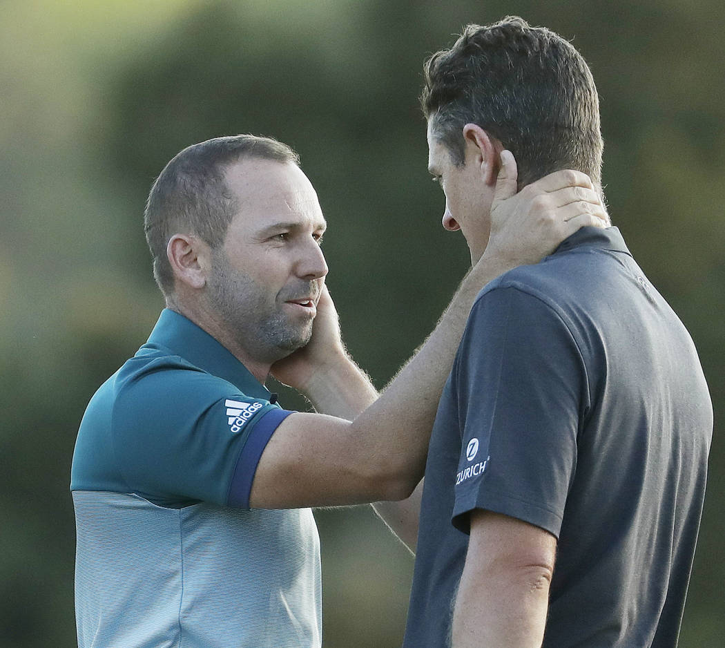 Sergio Garcia, of Spain, talks to Justin Rose, of England, after making his birdie putt on the 18th green to win the Masters golf tournament after a playoff Sunday, April 9, 2017, in Augusta, Ga.  ...