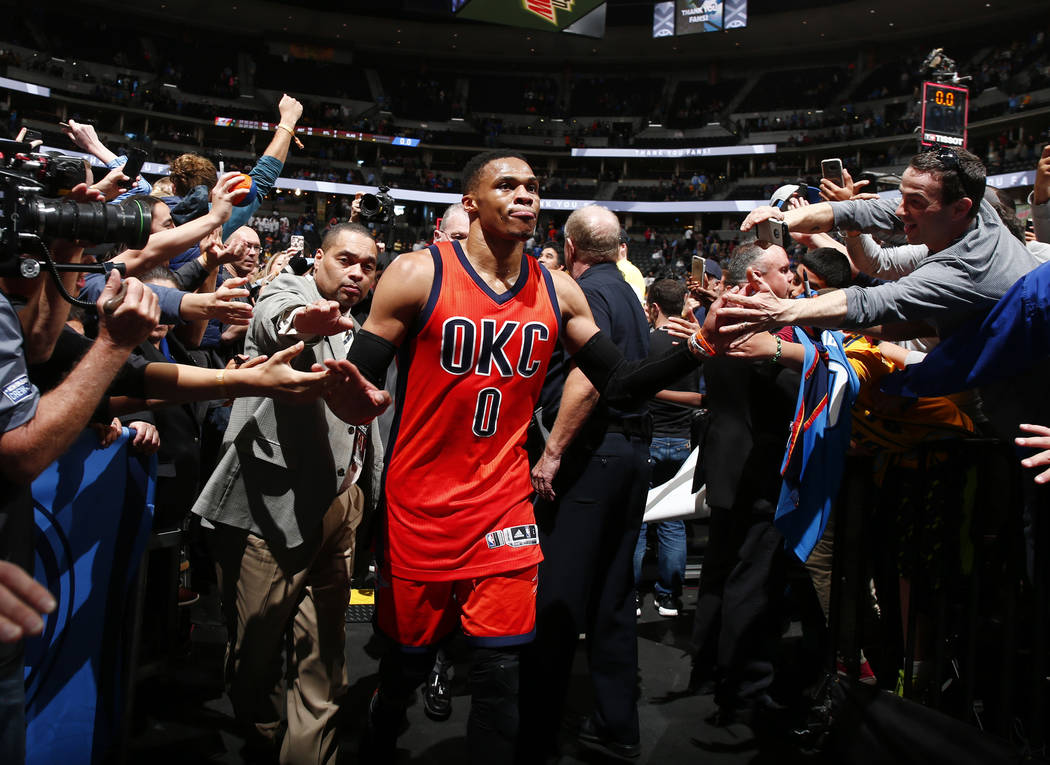 Oklahoma City Thunder guard Russell Westbrook celebrates after hitting a buzzer beating three point shot to win the game against the Denver Nuggets Sunday, April 9, 2017, in Denver. Oklahoma City  ...