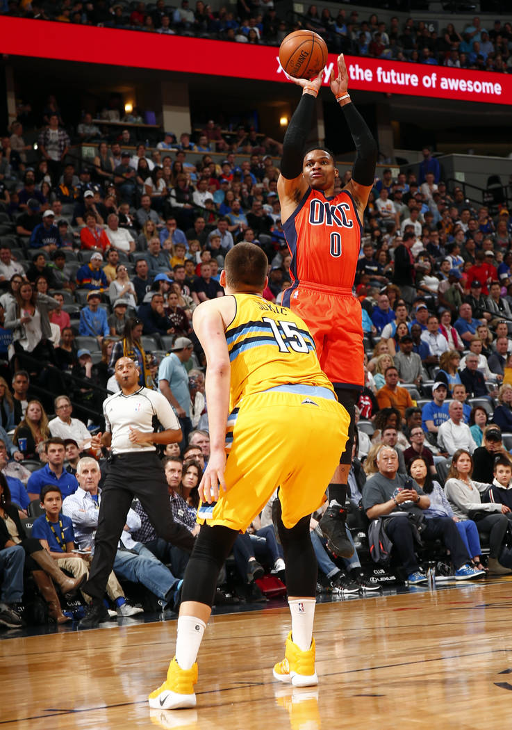 Oklahoma City Thunder guard Russell Westbrook takes a shot over Denver Nuggets forward Nikola Jokic (15) during the first half of a basketball game Sunday, April 9, 2017, in Denver. (Jack Dempsey  ...