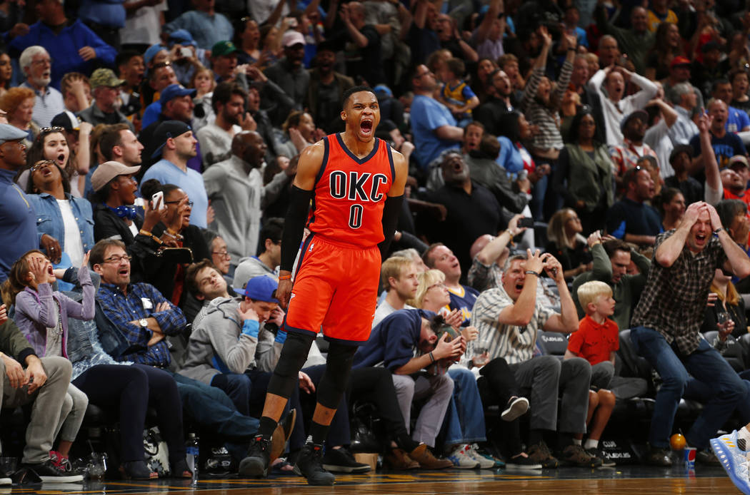 Oklahoma City Thunder guard Russell Westbrook celebrates after hitting a buzzer beating three-point shot to win the game against the Denver Nuggets following a basketball game Sunday, April 9, 201 ...