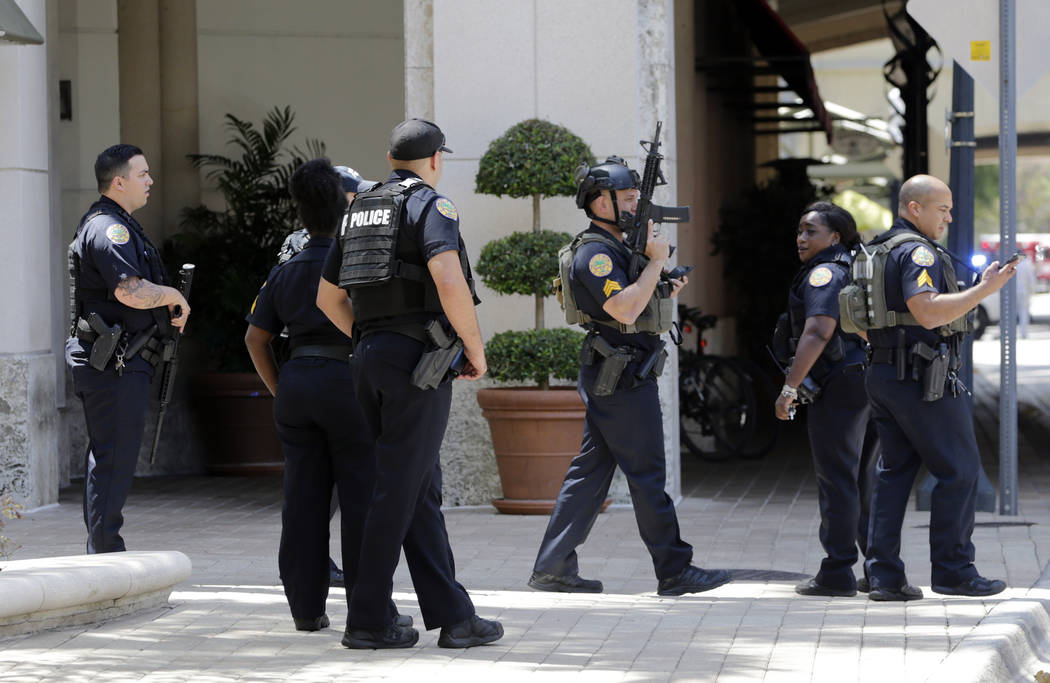 Police patrol outside of the Shops at Merrick Park after a shooting, Saturday, April 8, 2017, in Coral Gables, Fla.   Alvaro Zabaleta of the Miami-Dade Police Department says detectives have respo ...