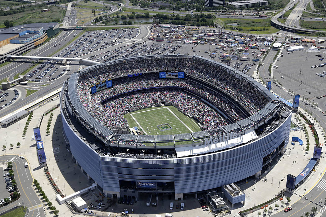 FILE - This Friday, June 20, 2014, file photo shows an aerial view of MetLife Stadium in East Rutherford, N.J. 2026 World Cup soccer games could be played in a number of modern stadiums across Nor ...