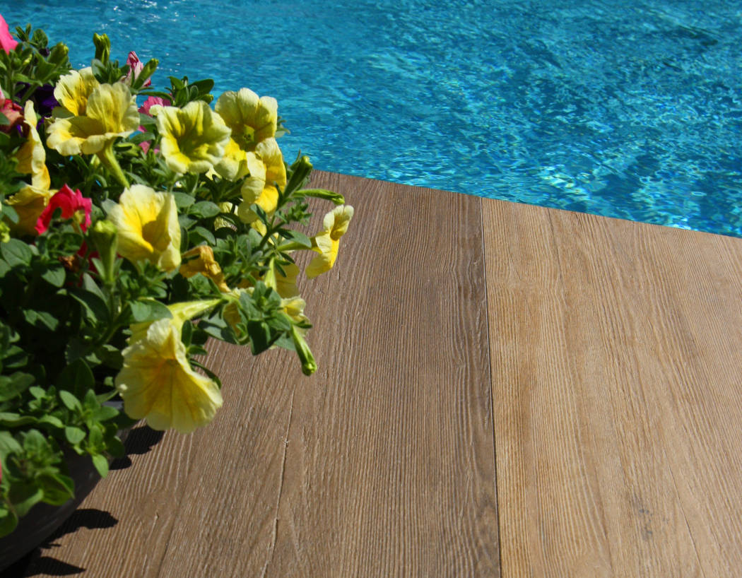 Mary Vail Belgard's Sundeck Transitional Collection features 1-by-4-foot planks with a wood grain look finish. Planks can be installed in a stacked bond (as shown) or a running bond pattern. Col ...