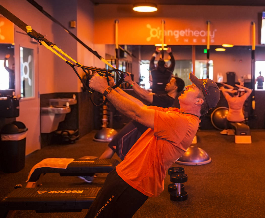 Owner Michael Worley works with resistance bands during a training session at Orangetheory Fitness on Wednesday, April 5, 2017, in Las Vegas. (Benjamin Hager/Las Vegas Review-Journal) @benjaminhphoto