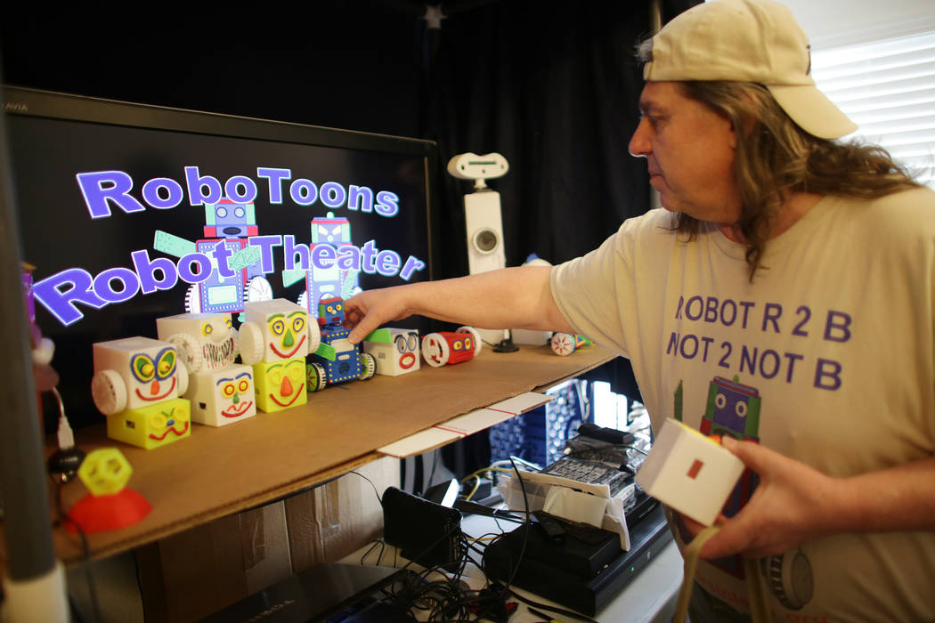 Walt Perko stacks robot parts at his home on Tuesday, April 11, 2017, in Las Vegas. He is working on a program called RoboGuts that teaches kids and hobbyists how to make robots. (Rachel Aston/Vie ...