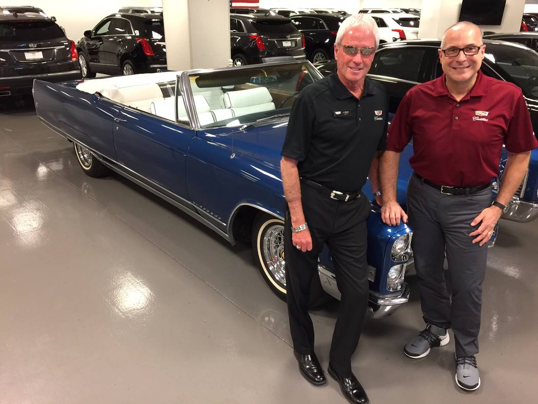 Findlay Automotive Entertainer and Findlay Cadillac marketing/promotion director and sales executive L.J. Harness, left, and Findlay Cadillac General Manager John Saksa are seen with a classic Cad ...