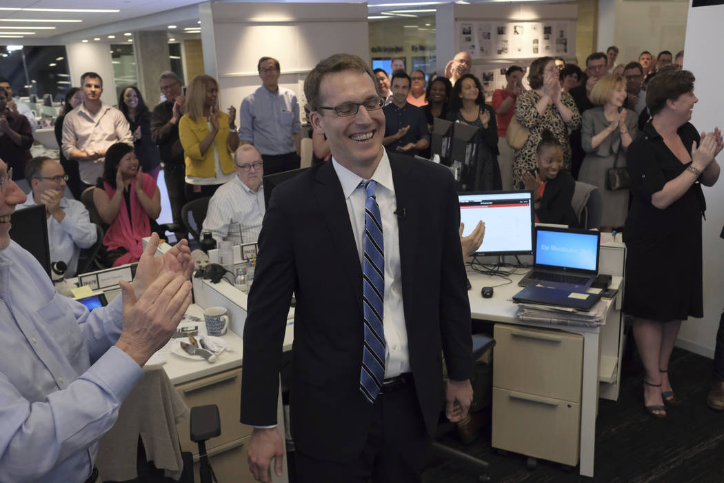 Members of the Washington Post staff congratulate David Fahrenthold, center, upon learning that he won the Pulitzer Prize for National Reporting, for dogged reporting of Donald Trump's philanthrop ...