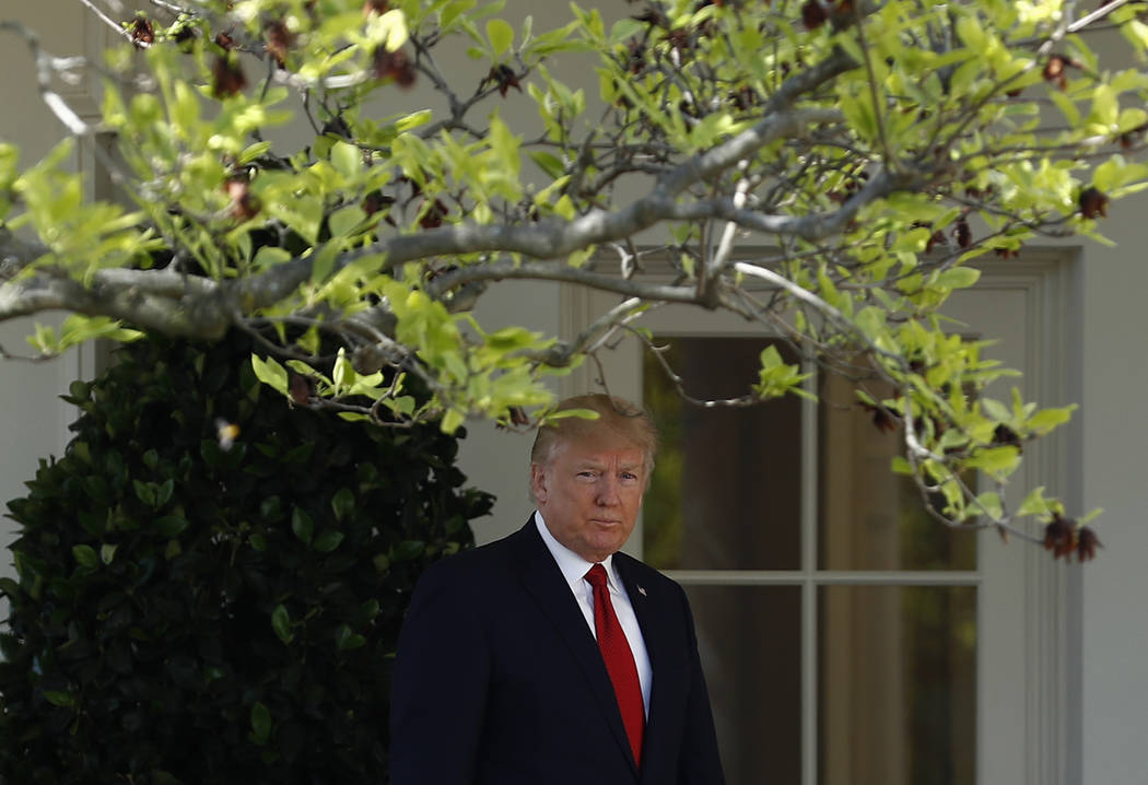 President Donald Trump arrives in the Rose Garden of the White House, Monday, April 10, 2017, for Supreme Court Justice Neil Gorsuch's public swearing-in ceremony. (Carolyn Kaster/AP)