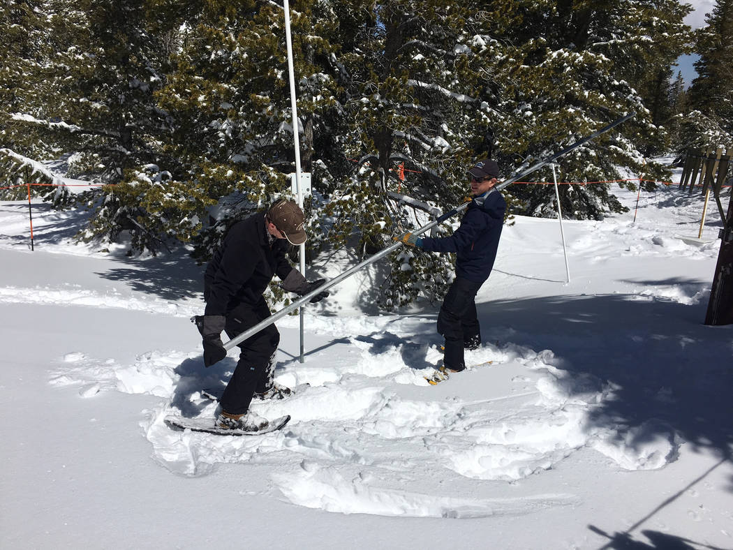 Jim Gifford, left, and Jeff Anderson, both with the Natural Resources Conservation Service, get ready to take another measurement at a Mount Rose measuring station on Monday, April 10, 2017. Sean  ...