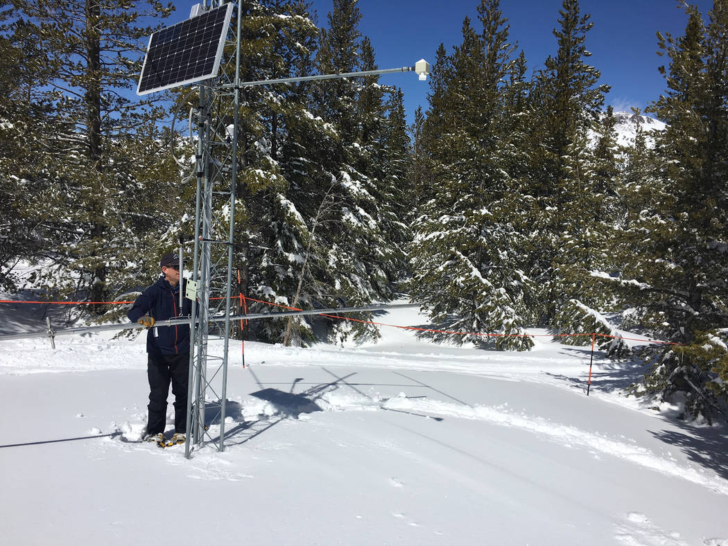 Jeff Anderson with the Natural Resources Conservation Service, weighs the snow in the tube to determine water content. Sean Whaley Las Vegas Review-Journal