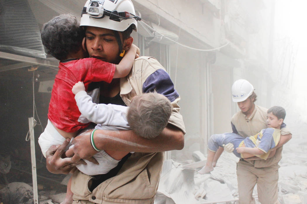 """Children are rescued from the rubble in the documentary """"Cries from Syria."""" (HBO)"""