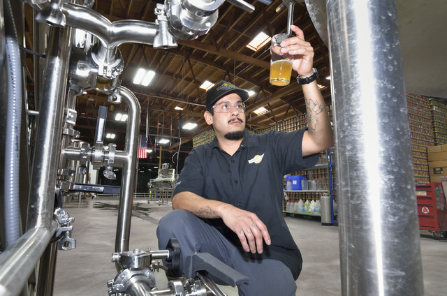 Assistant brewer Marcos Lopez checks a beer for clarity at Tenaya Creek Brewery at 831 W. Bonanza Road on Friday, Sept. 9, 2016. (Bill Hughes/Las Vegas Review-Journal)