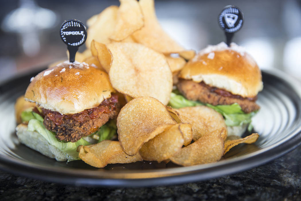 Crispy sea bass sliders with cottage dill rolls, remoulade, tomato jam, butter sauce and salt and vinegar chips at Topgolf Las Vegas on Monday, April 10, 2017, at the MGM Grand hotel/casino, in La ...