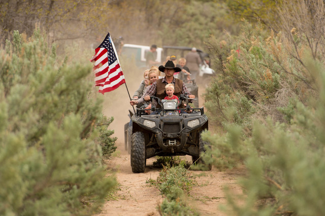Ryan Bundy, son of the Nevada rancher Cliven Bundy, rides an ATV into Recapture Canyon north of Blanding, Utah on Saturday, May 10, 2014, in a protest against what demonstrators call the federal g ...