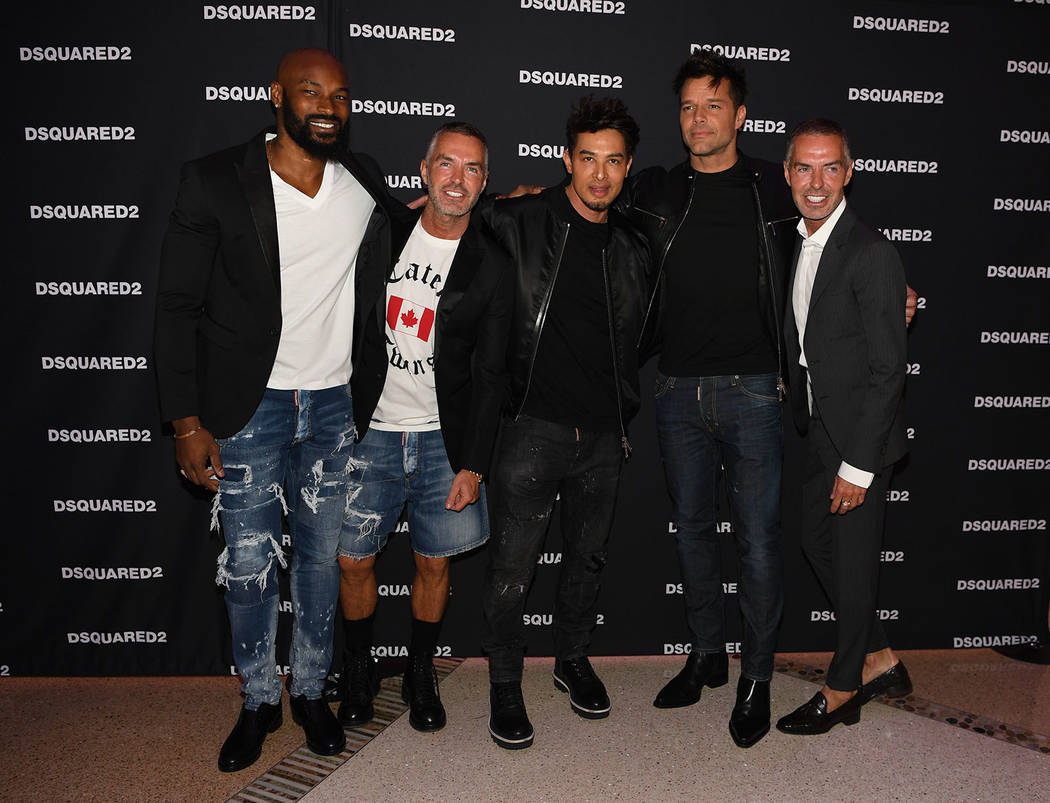 Tyson Beckford, Jamie King, center, and Ricky Martin, second from right, attend the grand opening of Dsquared2 Store, Canadian fashion designers and twin brothers Dan and Dean Caten's new outlet,  ...