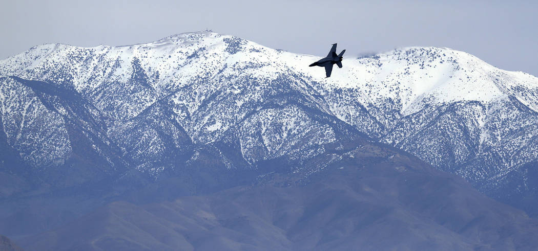 In this Feb. 27, 2017, photo, an F/A-18E Super Hornet from VFA-24 squadron at NAS Lemoore banks in front of the Panamint range while exiting the nicknamed Star Wars Canyon on the Jedi transition o ...