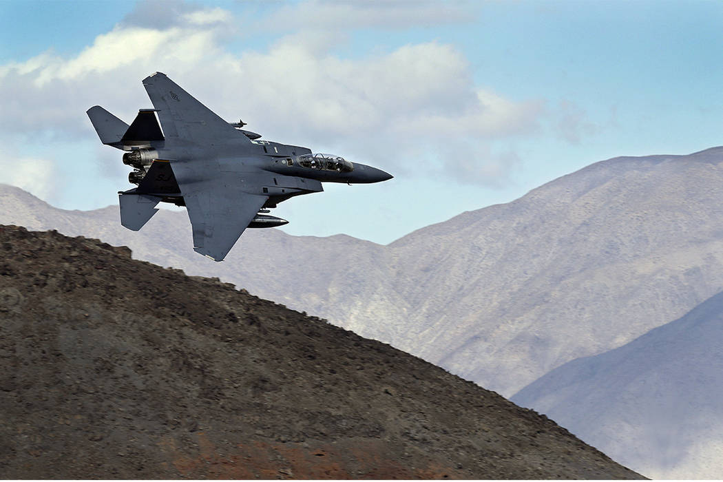 In this Feb. 27, 2017, photo , an F-15E 22 Eagle from Seymour Johnson AFB in North Carolina flies out of the nicknamed Star Wars Canyon turning toward the Panamint range over Death Valley National ...