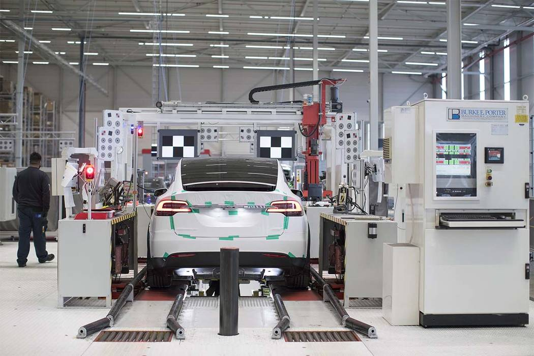 A Tesla Model X sports utility vehicle (SUV) undergoes wheel alignment checks during assembly for the European market at the Tesla Motors factory in Tilburg, Netherlands on Dec. 9, 2016. (Bloomber ...
