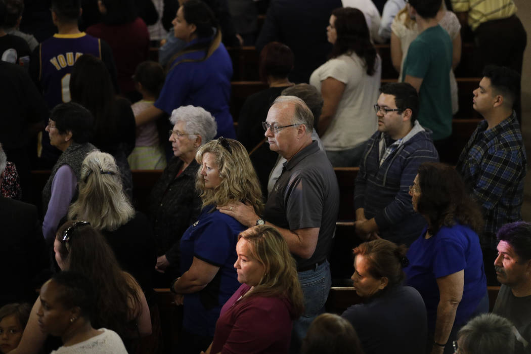 People attend a prayer service to honor the shooting victims at North Park Elementary School, Monday, April 10, 2017, in San Bernardino, Calif. A man walked into his estranged wife's elementary sc ...