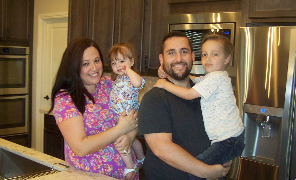 Andrew and Gina Lanzino, along with their children, Joey and Bella, relax in the model-home-inspired kitchen of their brand new home by Century Communities at Alpine Crossings in Skye Canyon. (Cou ...