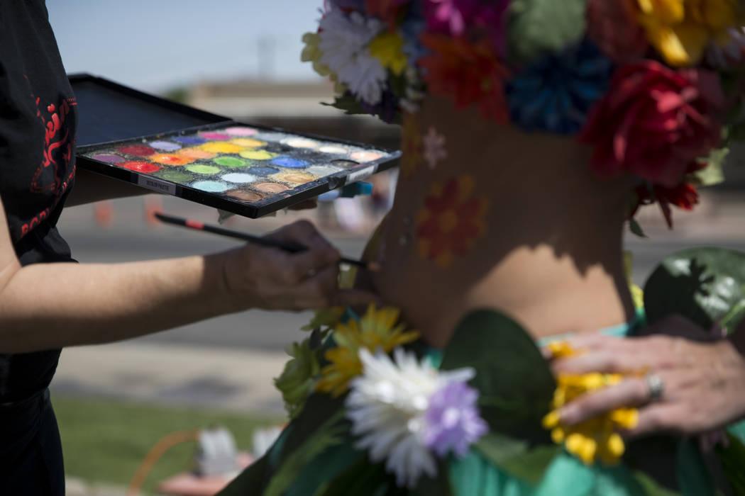 Artist Robin Slonina, left, paints Alissa Banks during the annual Henderson Heritage Parade and Festival on Saturday, April 15, 2017, in Henderson. Erik Verduzco Las Vegas Review-Journal @Erik_Ver ...