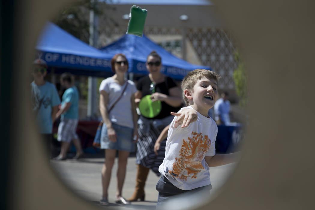 Alex Marudas, 5, tosses a bean bag during the annual Henderson Heritage Parade and Festival on Saturday, April 15, 2017, in Henderson. Erik Verduzco Las Vegas Review-Journal @Erik_Verduzco