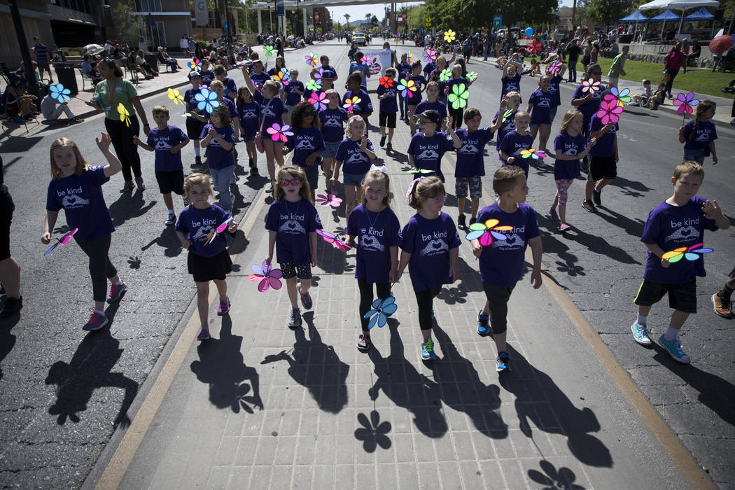 Children with the Safekey and Teen Scene program during the annual Henderson Heritage Parade and Festival on Saturday, April 15, 2017, in Henderson. Erik Verduzco Las Vegas Review-Journal @Erik_Ve ...