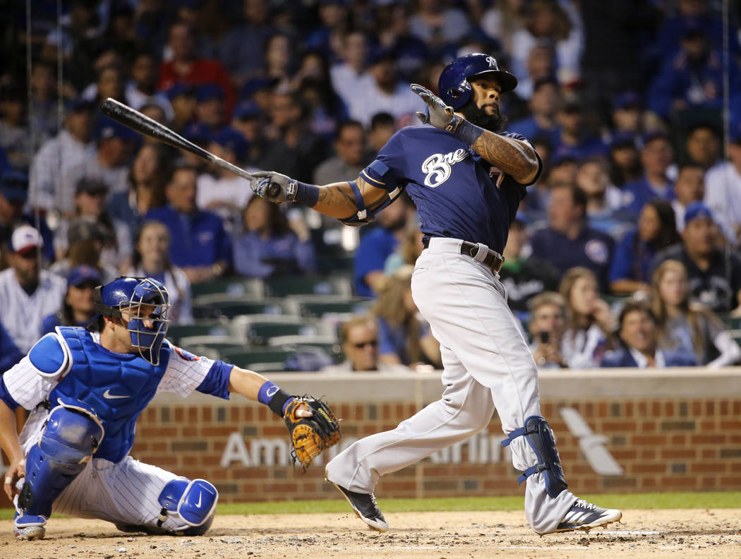 Milwaukee Brewers' Eric Thames hits a double off Chicago Cubs starting pitcher Brett Anderson during the third inning of a baseball game Tuesday, April 18, 2017, in Chicago. (AP Photo/Charles Rex  ...