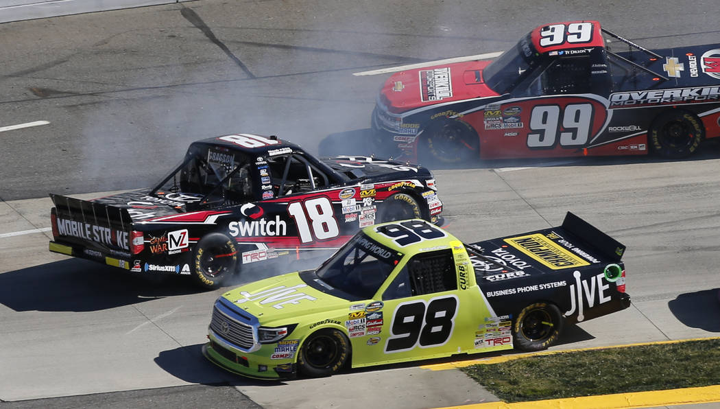 Noah Gragson (18) spins out as Grant Enfinger (98) and Ty Dillon (99) pass by during the NASCAR Truck Series auto race at Martinsville Speedway in Martinsville, Va., Saturday, April 1, 2017. (AP P ...