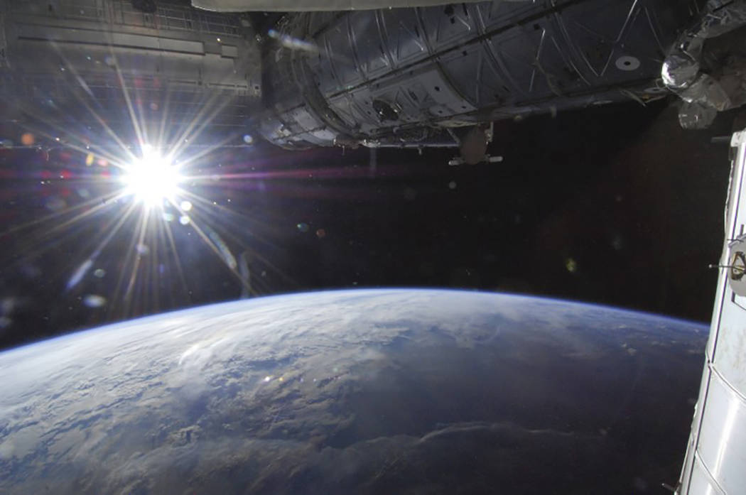 The sun is captured over Earth's horizon by one of the Expedition 36 crew members aboard the International Space Station, as the orbital outpost was above a point in southwestern Minnesota in this ...