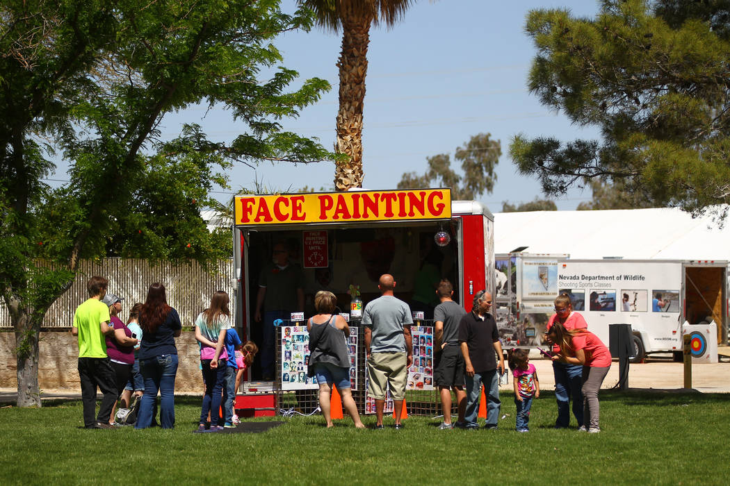 People line up for face painting during the first day of the Clark County Fair and Rodeo in Logandale on Wednesday, April 12, 2017. Chase Stevens Las Vegas Review-Journal @csstevensphoto